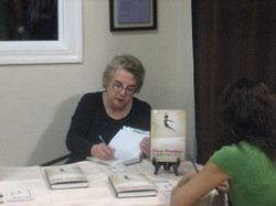 Sept_2007_toba_signing_book_at_city